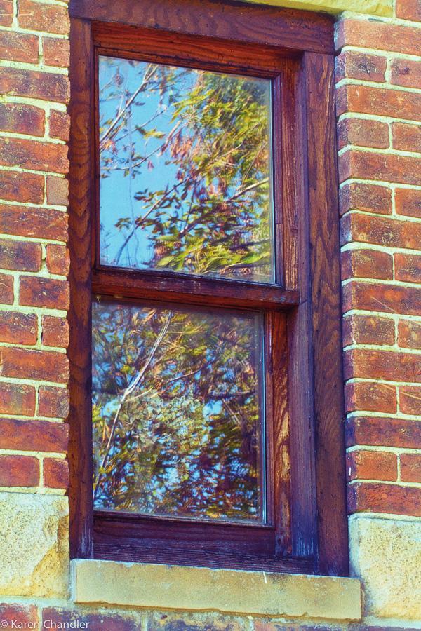 handcrafted window in restored brick church