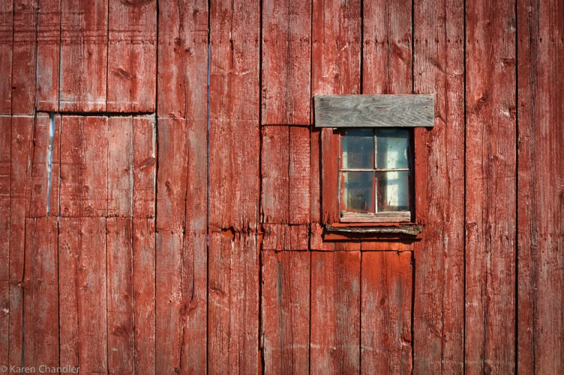 window in antique red barn