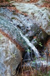 A waterfall trickled over a large granite slab. Only a small portion of the stone is shown.