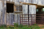 old barn and rusted gate